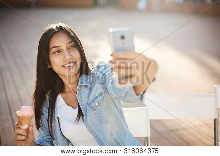 Youth, Leisure And Fun Concept. Attractive Carefree Young Woman Enjoy Sunny Weekend, Taking Selfie W