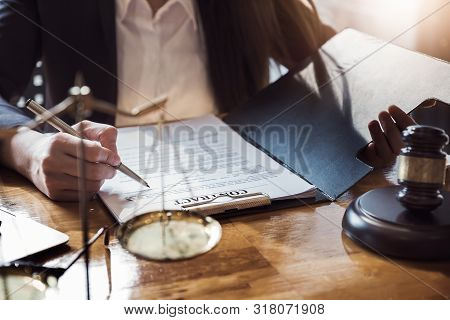 Law Concept, Lawyer Woman Hoding Pen With Contract Or Agreement Document To Customer For Signing In