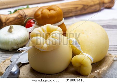 Italian Provolone Or Provola Caciocavallo Hard And Smoked Cheeses In Teardrop Form Served On Old Pap