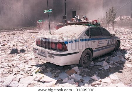 NEW YORK - SEPTEMBER 11: Ash covers a NYPD vehicle as it lies near the area known as Ground Zero after the collapse of the Twin Towers on September 11, 2001 in New York City.