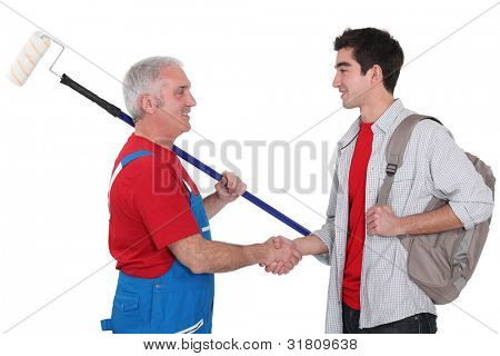 Experienced tradesman welcoming his new recruit