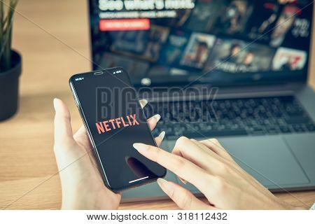 Bangkok, Thailand - August 21, 2019 : Women Use Netflix App On Smartphone Screen. Netflix Is An Inte