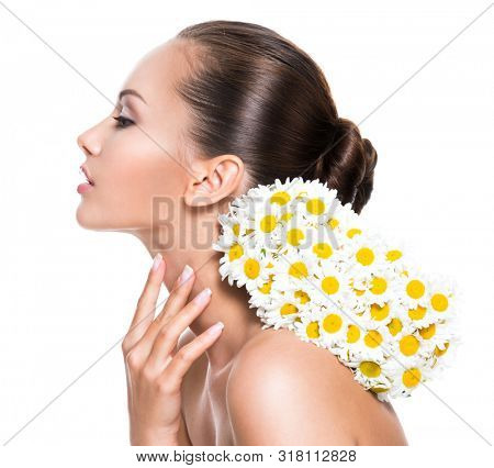 Young beautiful woman with posy flowers touching neck - isolated on white background