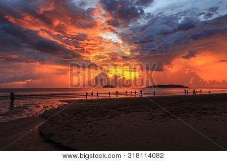 Beautiful Sunset With Silhouette Tourist At Tanjung Aru Beach, Kota Kinabalu, Sabah., Borneo. Tanjun