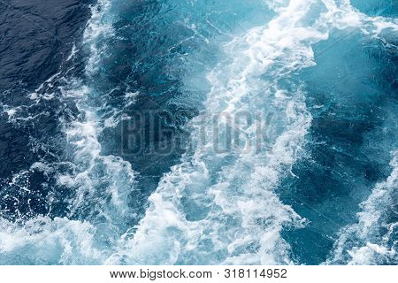 Wave Created By Ship Sails Pass Through The Sea Water. Turbulance Flow Of Sea Water Happen By The Sh
