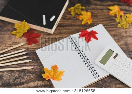 Back To School Tabletop Arrangement With Coloured Pencils Notepad And Mixed Stationery Items Among A