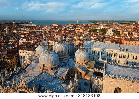 View of Venice with famous St Mark's Basilica and Doge's Palace on sunset from St Mark's Campanile bell tower, Venice, Italy