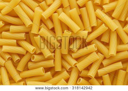 Dry Uncooked Tortiglioni Or Rigatoni Pasta As A Background.