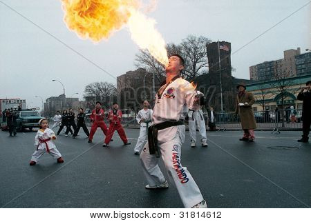 FLUSHING, NY - JANUARY 24: A fire breather performs at a Chinese New Year celebration on January 24, 2001 in Flushing, NY.