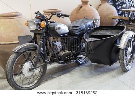 Parma, Italy - March 2019: Vintage Black Sidecar Inside An Antique Shop.