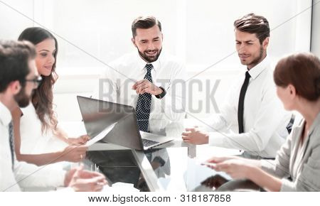 business team discusses new ideas at a working meeting