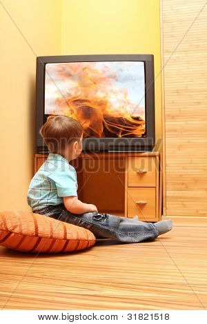 Little boy watching cinema on TV. TV screen - photo of the author