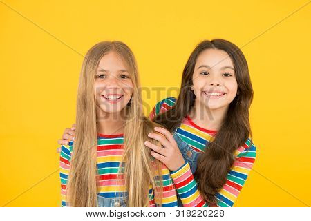 Long hair best female adorn. Girls blonde and brunette shiny healthy hair. Hair strengthening. Grow hair. Hairdresser salon. Kids beautiful friends or sisters with perfect hairstyles. Natural beauty. poster