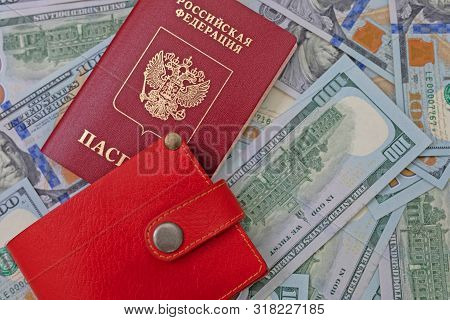 Russian international passport on a background of dollars. a Russian citizen is going abroad, exchanges rubles for dollars, is preparing to apply for a visa poster