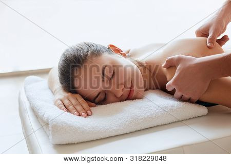 Spa Massage. Close-up Of Young Woman Getting Spa Massage Treatment At Beauty Spa Salon.spa Skin And