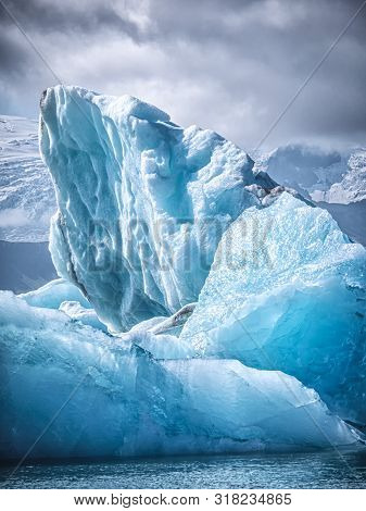 Beautiful Iceberg In The Jokulsarlon Glacier Lagoon. Global Warming Concept. Melting Glacier