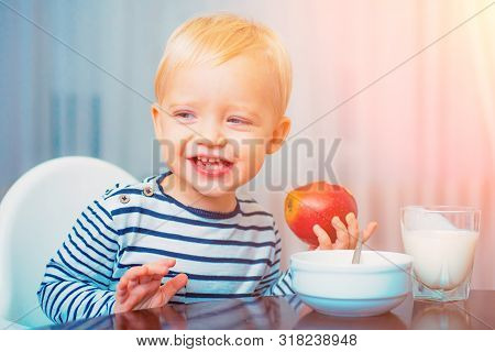 Kid Boy And Healthy Food. Boy Cute Baby Eating Breakfast. Baby Nutrition. Eat Healthy. Toddler Havin
