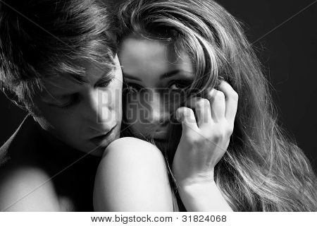 B and W portrait of a passionate couple