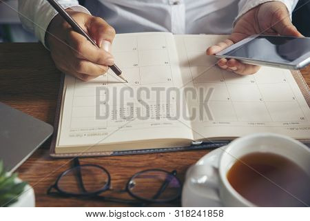 On 2020 Calendar Book,female'hand Of Planner Writing Daily Appointment.woman Mark And Noted Schedule