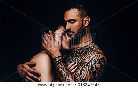 Man Hugging Woman With Love. Sensual Couple In Love. Erotic Love Of Hispanic Man And Sexy Woman.