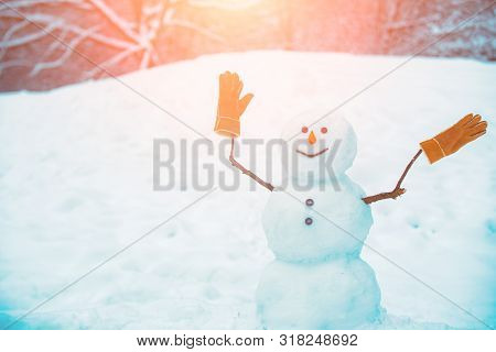 Greeting Snowman. Cute Snowmen Standing In Winter Christmas Landscape. The Morning Before Christmas.