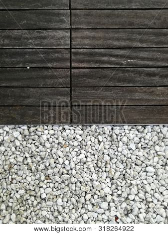 White Pebble Stone And Wood. Gravel Is A Loose Aggregation Of Rock Fragments. Gravel Is Classified B