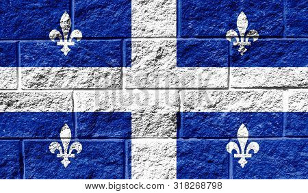 Flag Of Quebec Close Up Painted On A Cracked Wall