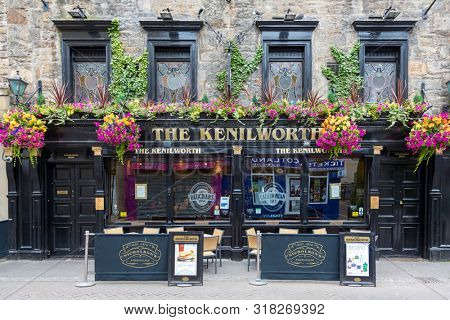 Edinburgh, Scotland - 9th August 2015: Traditional Scottish pub, The Kenilworth, in Ediburgh, Scotland. Historical Victorian building with Arts and Crafts style stained glass windows. Wide view