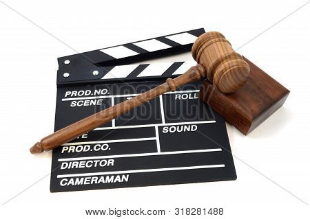 An Isolated Shot Of A Movie Production Clapboard And Judges Gavel For Illustration Of Industry Laws
