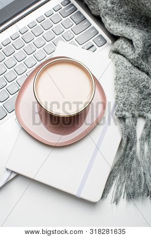 Beautiful Enameled Pink Cup Of Coffee With Blanket And Laptop