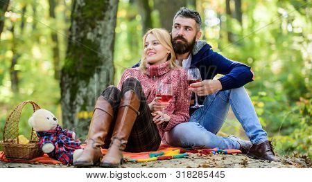 Enjoying Their Perfect Date. Happy Loving Couple Relaxing In Park Together. Romantic Picnic With Win