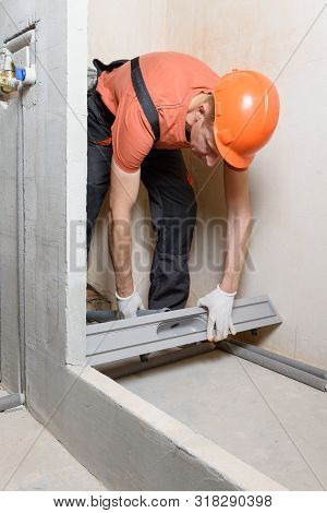The Worker Is Installing A Drain For Water In The Shower Box.