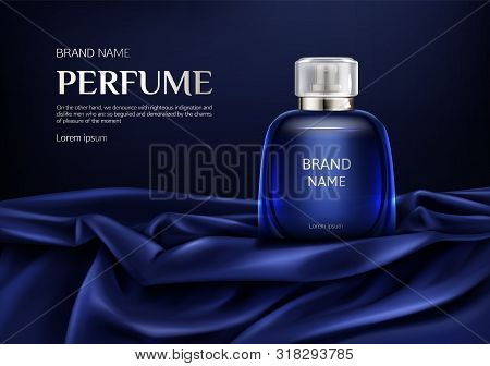 Perfume Bottle On Silk Folded Fabric Background. Glass Flask With Dark Blue Liquid, Packaging Design