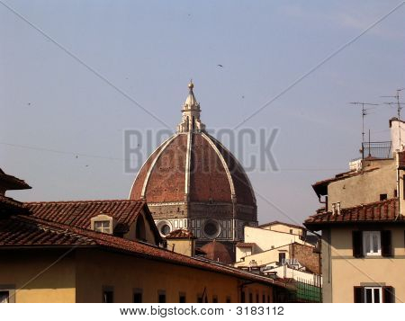 Bell Tower Of Duomo Viewed Across Rooftops.