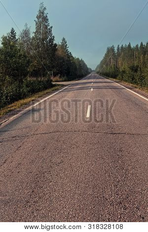 The Mist Covers The Empty Road On A Late Summer Morning At The Rural Finland. There Are Nobory Drivi