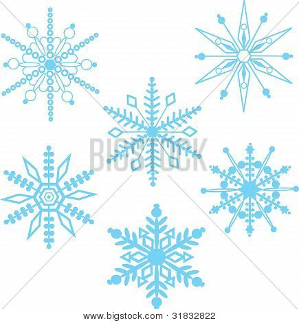 A seamless pattern comprised of stylized, white snowflakes, over a pale blue background. poster