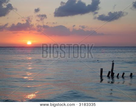 Sunrise With Jetty Supports