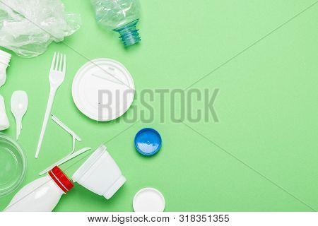 Garbage Collection, Plastic On A Green Background. Concept Stop Plastic, Recycling, Separate Collect