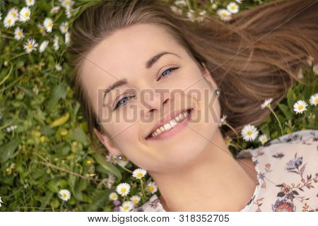 Summertime In Garden. Portrait Of A Happy Young Woman With Perfect Skin.