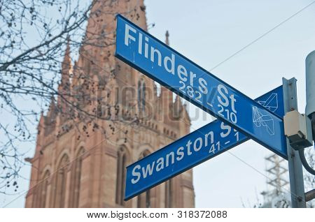 Melbourne, Australia - July 29, 2018: Street Signs Of Flinders St And Swanston St In Front Of St Pau