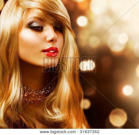 Blond Hair. Blonde .Beautiful Girl Portrait. Golden background
