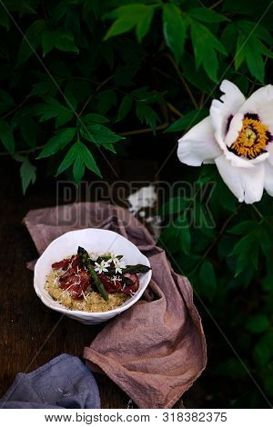 Quinoa Risotto With Asparagus.outdoor Photo.style Rustic.selective Focus