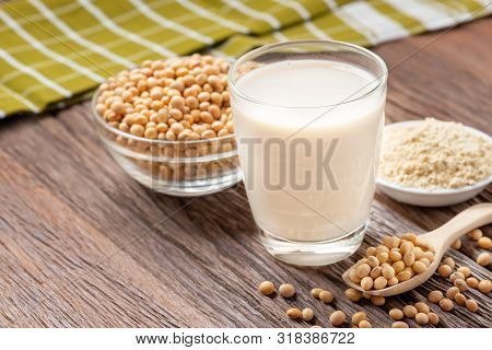 Homemade Soy Milk And Soybean With Soy Flour On Wooden Background, Healthy Drink.