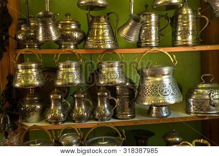 Traditional Turkish metal utensils with coinage in a souvenir shop
