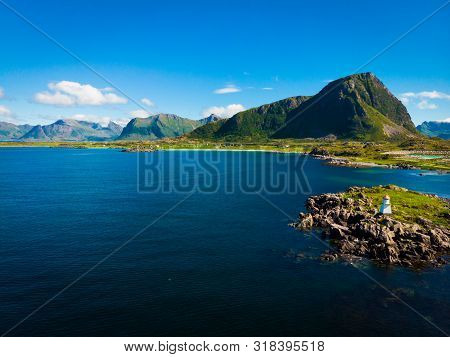 Scenic Seascape With Lighthouse At Hovsund Fishing Port, Gimsoya Lofoten Islands In Norway