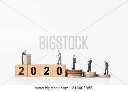 Miniature People : Business People Standing On Wooden Block Number 2020