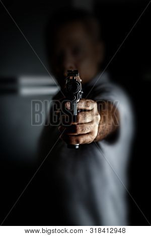 Man Carrying A Toy Gun To Rob The Money. Robber In The Shadow With Toy Gun Rob Money. Concept Pictur