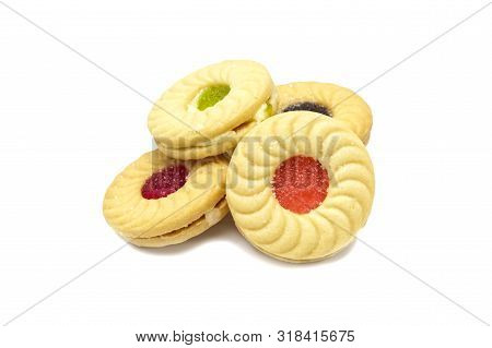 Biscuit Sandwich Butter Cookies With Cream And Mixed Fruits Flavoured Jam. A Stack Of Crunchy Delici