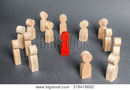 Red Human Figure Surrounded By A Group Of People. Leader Boss And Leadership. Cooperation And Teamwo