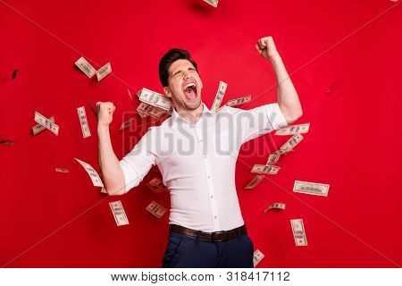 Photo Of Overjoyed Ecstatic Man Throwing His Money And Standing In Its Rain While Isolated With Red